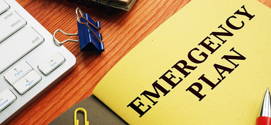 Booklet that reads Emergency Plan on desk