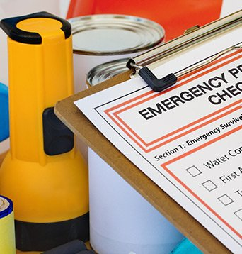 Clipboard with checklist for emergency supplies.