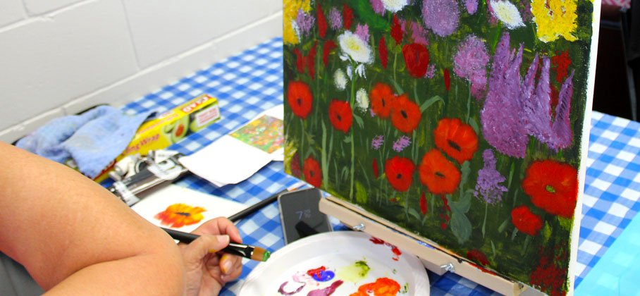 flower canvas painting on checkered table cloth