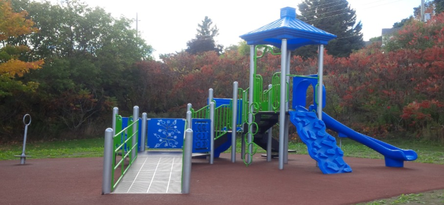 playground equipment including a slide and climbing wall
