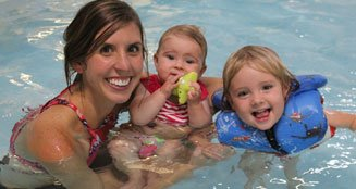 Family enjoying the therapy pool at Jack Burger Sports Complex