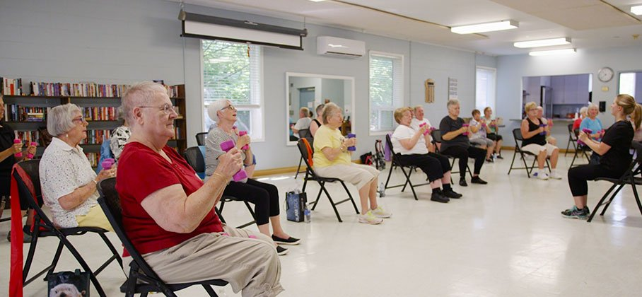 Picture of seniors participating in a Tai Chi progra,