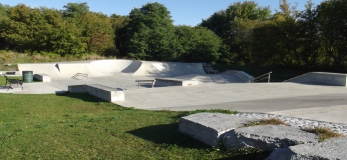 concrete skate park with ramps and rails