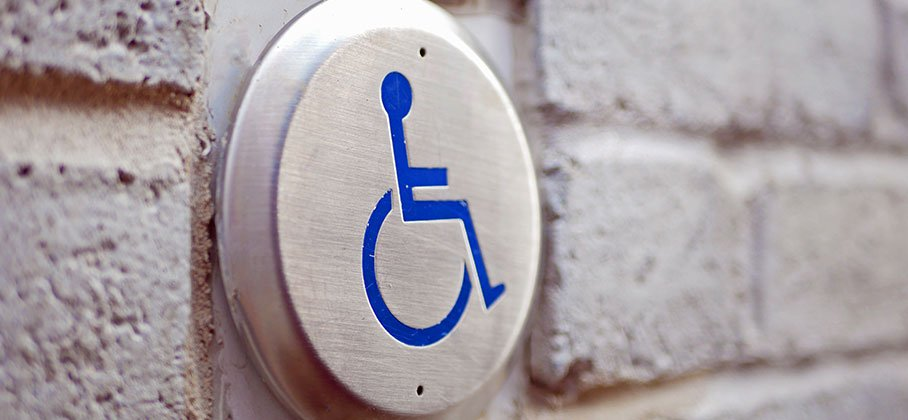 Wheelchair button on side of building