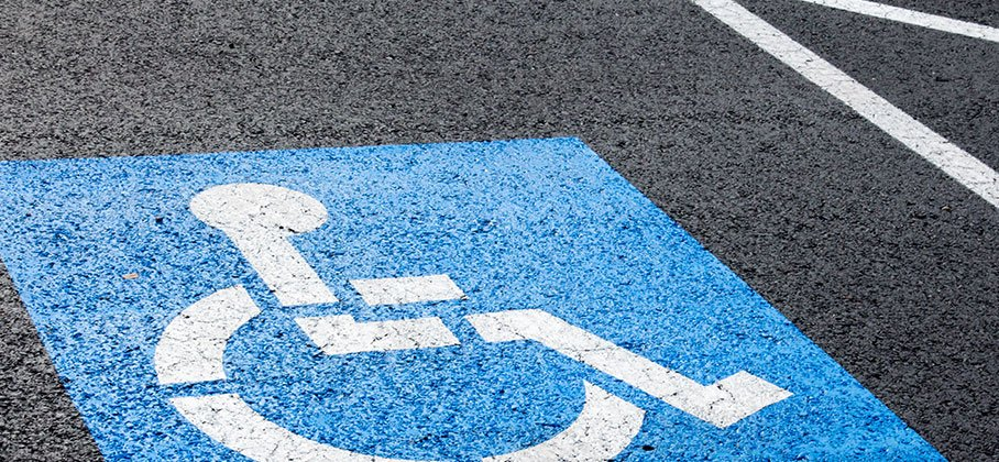 Pavement with wheelchair symbol painted on it