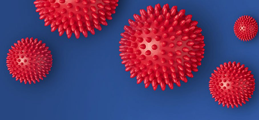 blue background with pink spikey balls on it
