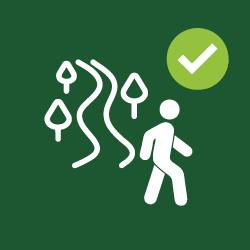 clip art of person walking on trail in forest
