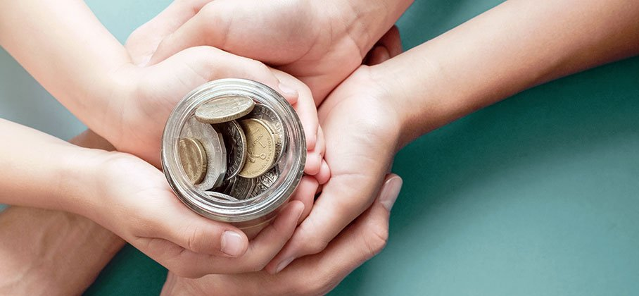 hands around a jar of money